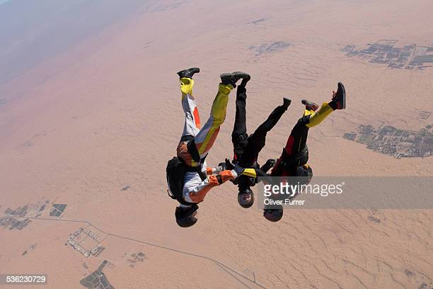 Skydiver team flying head over with 150mph