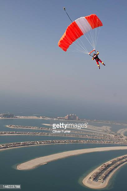 Skydiver under canopy over the Dubai palm islands