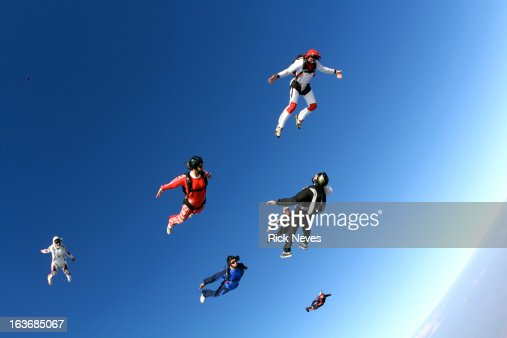 Skydivers flying in formation : Stock Photo