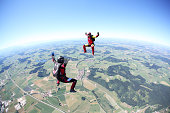 Skydivers having fun above Leutkirch, Bavaria, Germany