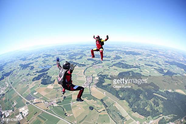 Skydivers having fun above Leutkirch, Bavaria, Germany