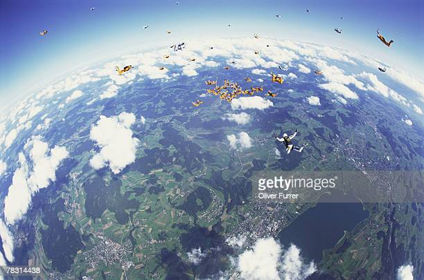 Skydivers hovering in the sky