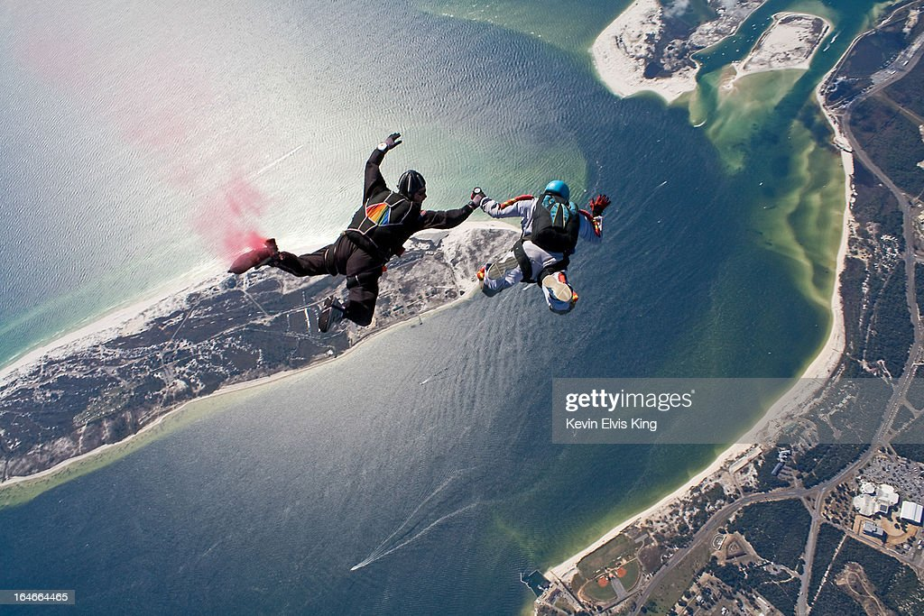Two skydivers exit the jump aircraft