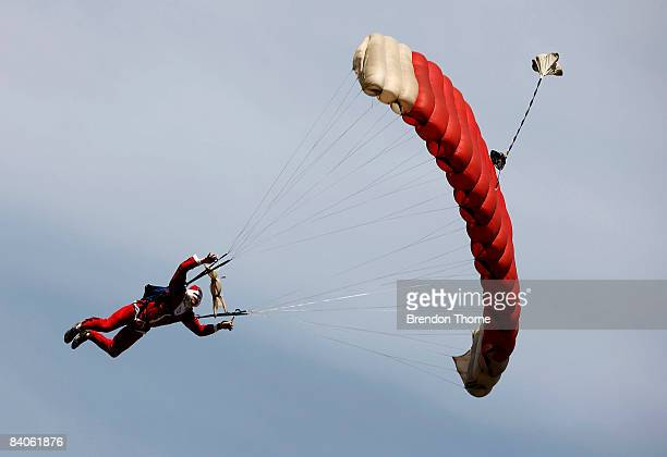 Skydivers in Santa Claus costumes dive in formation over Sydney to launch the new festive experiences range by an Australian online experience...