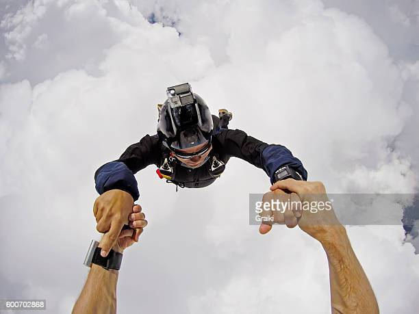 Skydivers inside the clouds pov