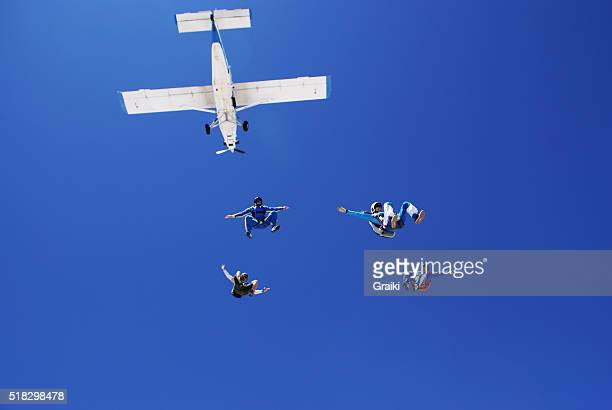 Skydivers jump from the plane