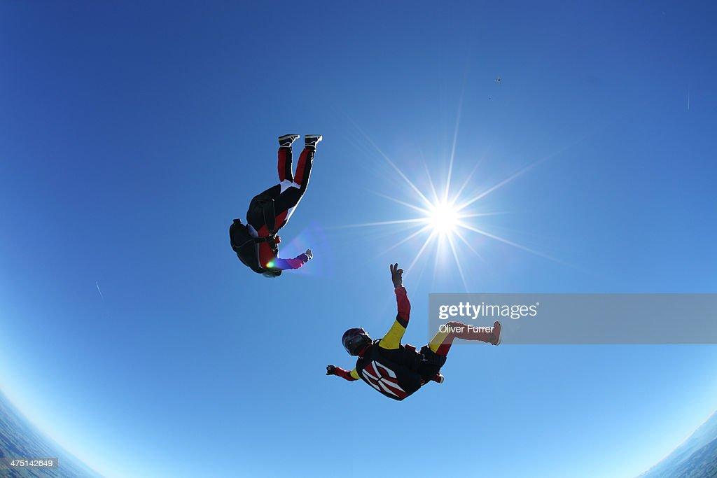 Skydivers upside down above Leutkirch, Bavaria, Germany