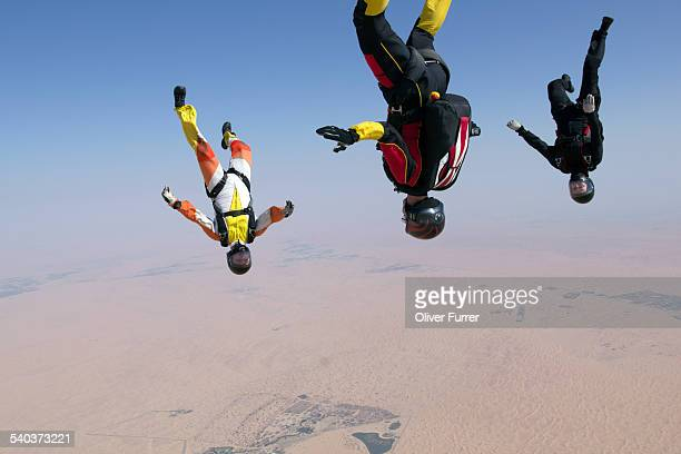 Skydiving team flying headover together