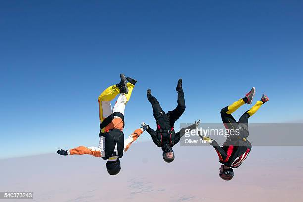 Skydiving team headover flying together