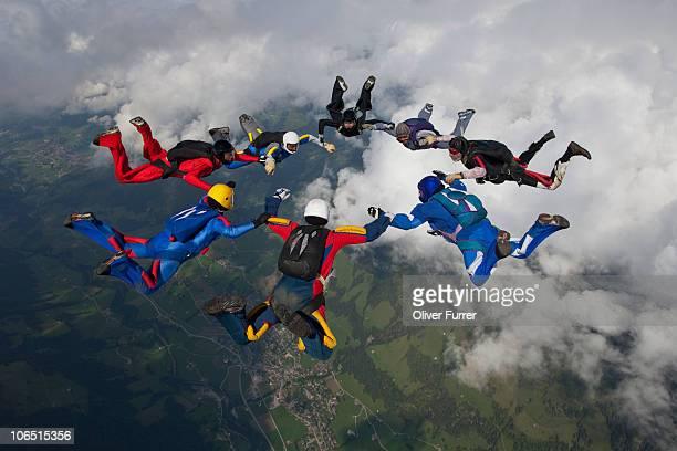 Skydiving team members are building a sky star.