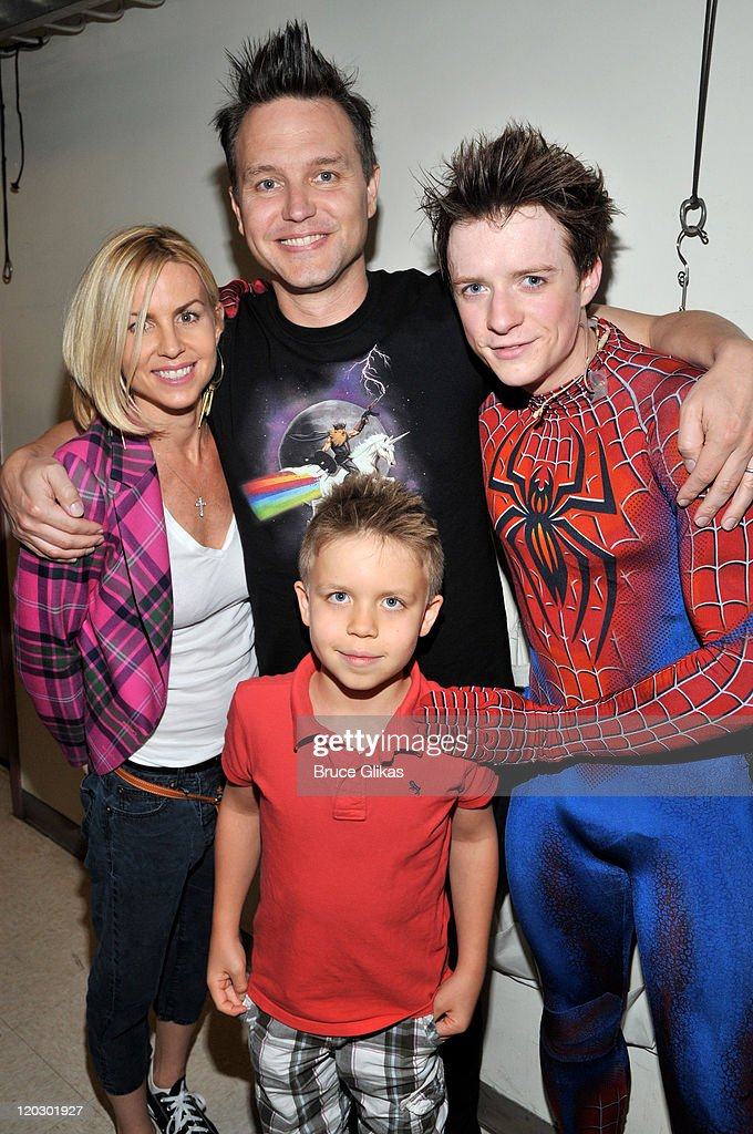 Skye Everly, husband Mark Hoppus of Blink-182, son Jack Hoppus and Matthew James Thomas as 'Spider-Man' pose backstage at the hit musical 'Spider-Man:Turn Off The Dark' on Broadway at The Foxwoods Theater on August 3, 2011 in New York City.