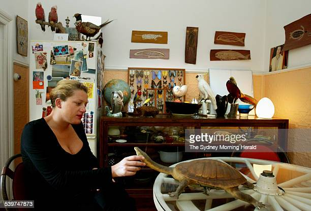 Skye Mccardle in her Bondi apartment and collection of stuffed birds 1 March 2006 SMH Picture by EDWINA PICKLES