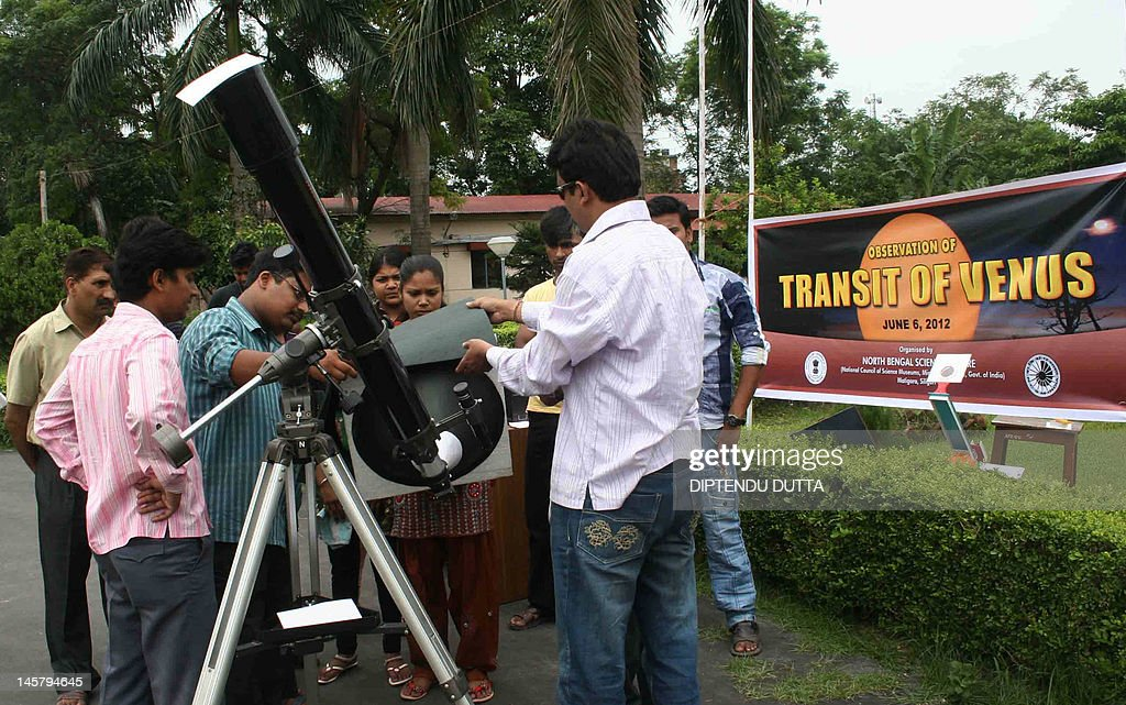 Skygazers look at a projected image from a telescope of Planet Venus in transit across the Sun in Siliguri on June 6, 2012. Astronomers around the world trained their telescopes on the skies to watch Venus pass in front of the Sun, a once-in-a-lifetime event that will not be seen for another 105 years. AFP PHOTO/Diptendu DUTTA