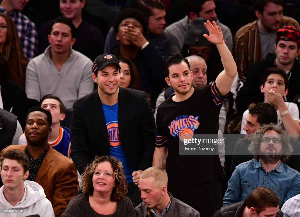 Skylar Astin and guest attend the Oklahoma City Thunder Vs New York Knicks game at Madison Square Garden on December 16, 2017 in New York City.