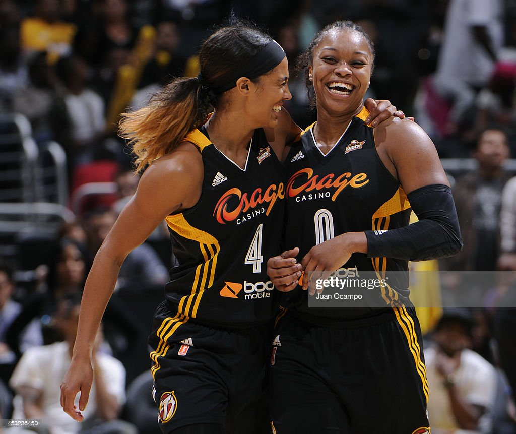 <a gi-track='captionPersonalityLinkClicked' href=/galleries/search?phrase=Skylar+Diggins&family=editorial&specificpeople=5791961 ng-click='$event.stopPropagation()'>Skylar Diggins</a> #4 and <a gi-track='captionPersonalityLinkClicked' href=/galleries/search?phrase=Odyssey+Sims&family=editorial&specificpeople=7412276 ng-click='$event.stopPropagation()'>Odyssey Sims</a> #0 of the Tulsa Shock celebrate during the game against the Los Angeles Sparks at STAPLES Center on August 5 2014 in Los Angeles, California.