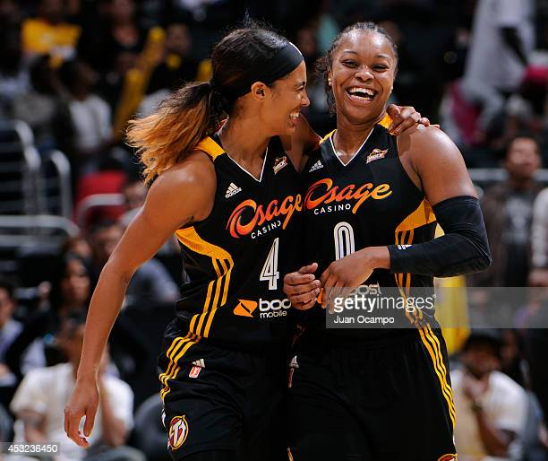 Skylar Diggins and Odyssey Sims of the Tulsa Shock celebrate during the game against the Los Angeles Sparks at STAPLES Center on August 5 2014 in Los...