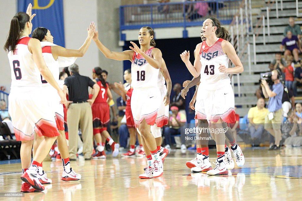 Skylar Diggins gives high fives during the Women's Senior US National Team Red vs White game on September 11 2014 in Newark DE NOTE TO USER User...