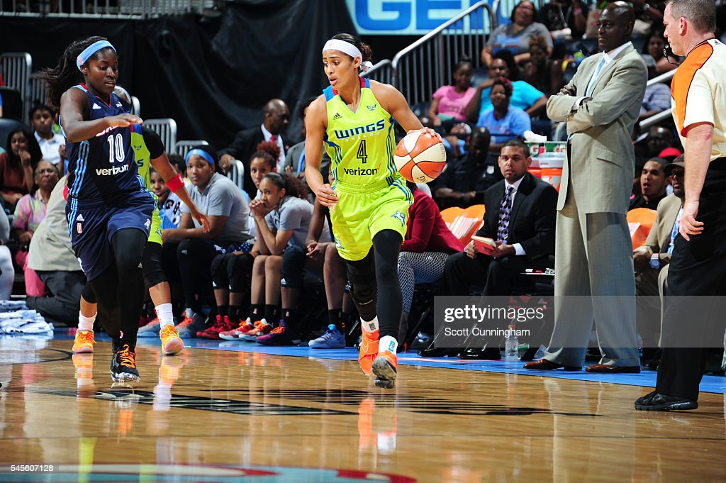 Skylar Diggins of the Dallas Wings brings the ball up court against Matee Ajavon of the Atlanta Dream on July 8 2016 at Philips Arena in Atlanta...