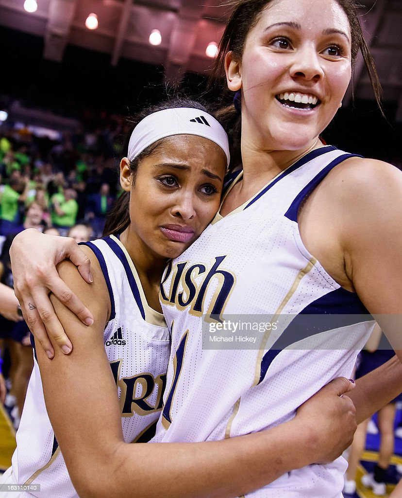 Skylar Diggins #4 of the Natalie Achonwa #11 of the Notre Dame Fighting Irish of the Notre Dame Fighting Irish celebrate after defeating the Connecticut Huskies at Purcel Pavilion on March 4, 2013 in South Bend, Indiana. Notre Dame defeated Connecticut 96-87 in triple overtime to win the Big East regular season title.