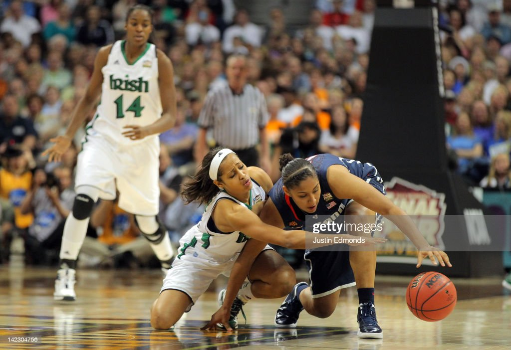 <a gi-track='captionPersonalityLinkClicked' href=/galleries/search?phrase=Skylar+Diggins&family=editorial&specificpeople=5791961 ng-click='$event.stopPropagation()'>Skylar Diggins</a> #4 of the Notre Dame Fighting Irish attempts to steal the ball from Kaleena Mosqueda-Lewis #23 of the Connecticut Huskies in the second half during the National Semifinal game of the 2012 NCAA Division I Women's Basketball Championship at Pepsi Center on April 1, 2012 in Denver, Colorado.