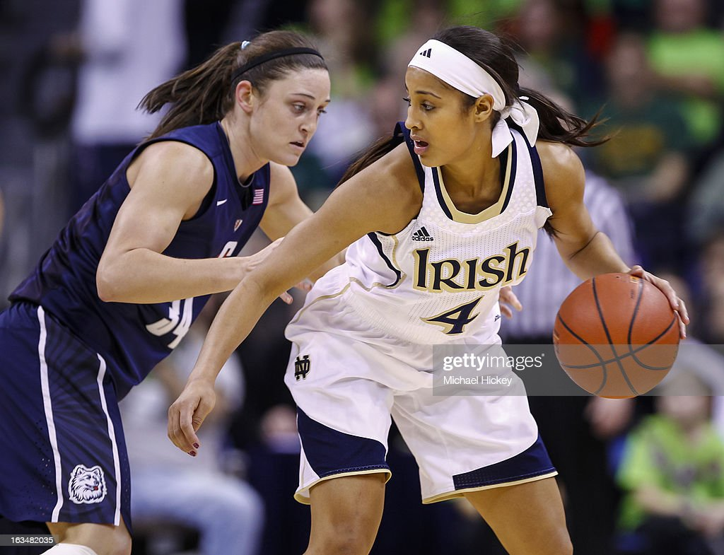 Skylar Diggins #4 of the Notre Dame Fighting Irish dribbles the ball against Kelly Faris #34 of the Connecticut Huskies at Purcel Pavilion on March 4, 2013 in South Bend, Indiana. Notre Dame defeated Connecticut 96-87 in triple overtime to win the Big East regular season title.