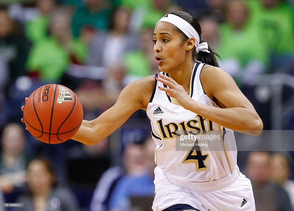 Skylar Diggins #4 of the Notre Dame Fighting Irish dribbles the ball up court during the game against the Louisville Cardinals at Purcel Pavilion on February 11, 2013 in South Bend, Indiana. Notre Dame defeated Louisville 93-64.