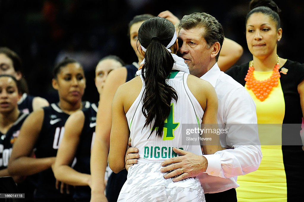 Skylar Diggins #4 of the Notre Dame Fighting Irish embraces Geno Auriemma, head coach of the Connecticut Huskies following the National Semifinal game of the 2013 NCAA Division I Women's Basketball Championship at the New Orleans Arena on April 7, 2013 in New Orleans, Louisiana. Connecticut won the game 83-65.