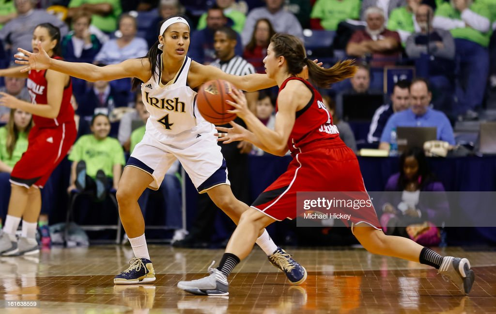 Skylar Diggins #4 of the Notre Dame Fighting Irish guards as Jude Schimmel #22 of the Louisville Cardinals attempts to pass the ball off at Purcel Pavilion on February 11, 2013 in South Bend, Indiana. Notre Dame defeated Louisville 93-64.