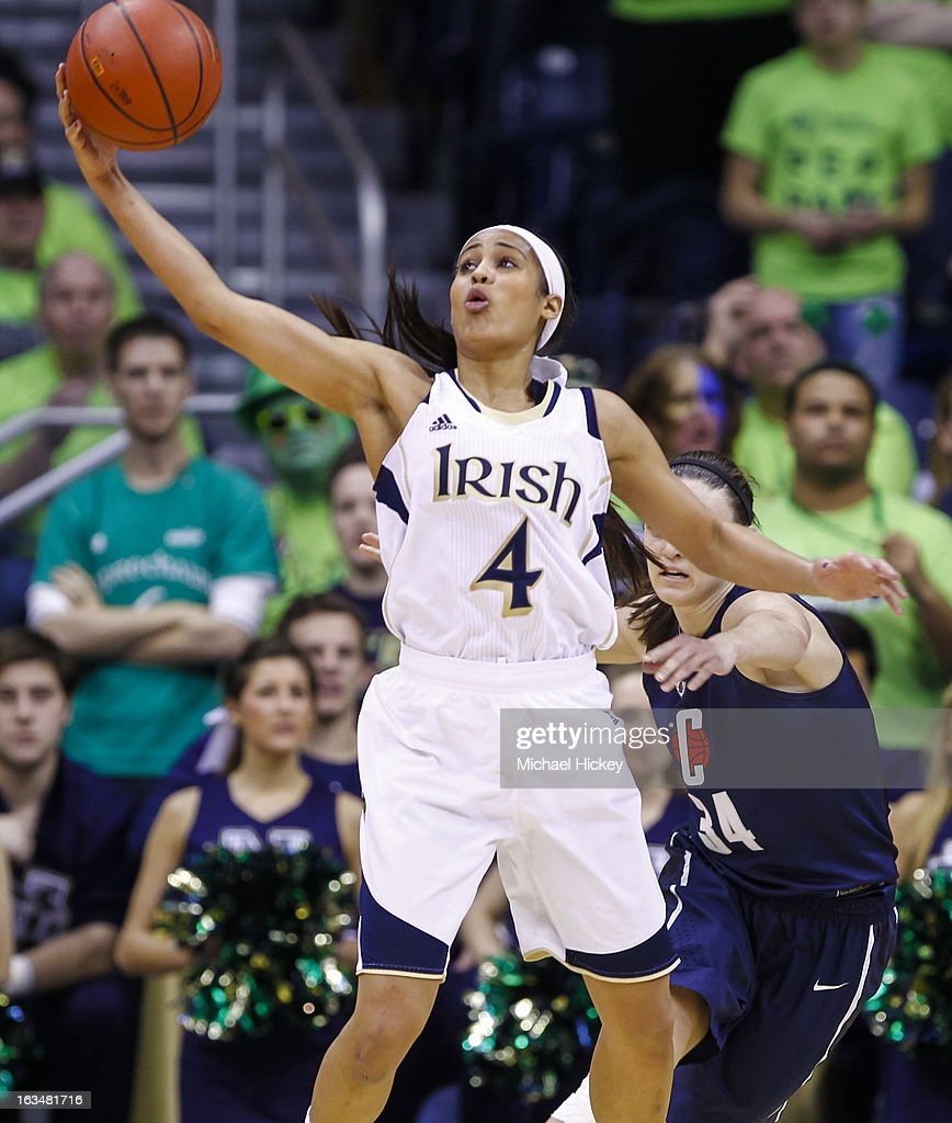 Skylar Diggins #4 of the Notre Dame Fighting Irish reaches for a pass during the game against the Connecticut Huskies at Purcel Pavilion on March 4, 2013 in South Bend, Indiana. Notre Dame defeated Connecticut 96-87 in triple overtime to win the Big East regular season title.