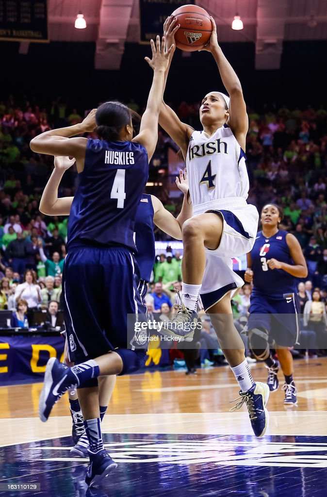 Skylar Diggins #4 of the Notre Dame Fighting Irish shoots the ball Moriah Jefferson #4 of the Connecticut Huskies at Purcel Pavilion on March 4, 2013 in South Bend, Indiana. Notre Dame defeated Connecticut 96-87 in triple overtime to win the Big East regular season title.