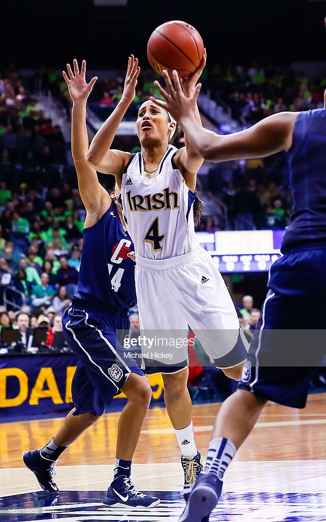 Skylar Diggins #4 of the Notre Dame Fighting Irish shoots the ball against the Connecticut Huskies at Purcel Pavilion on March 4, 2013 in South Bend, Indiana. Notre Dame defeated Connecticut 96-87 in triple overtime to win the Big East regular season title.