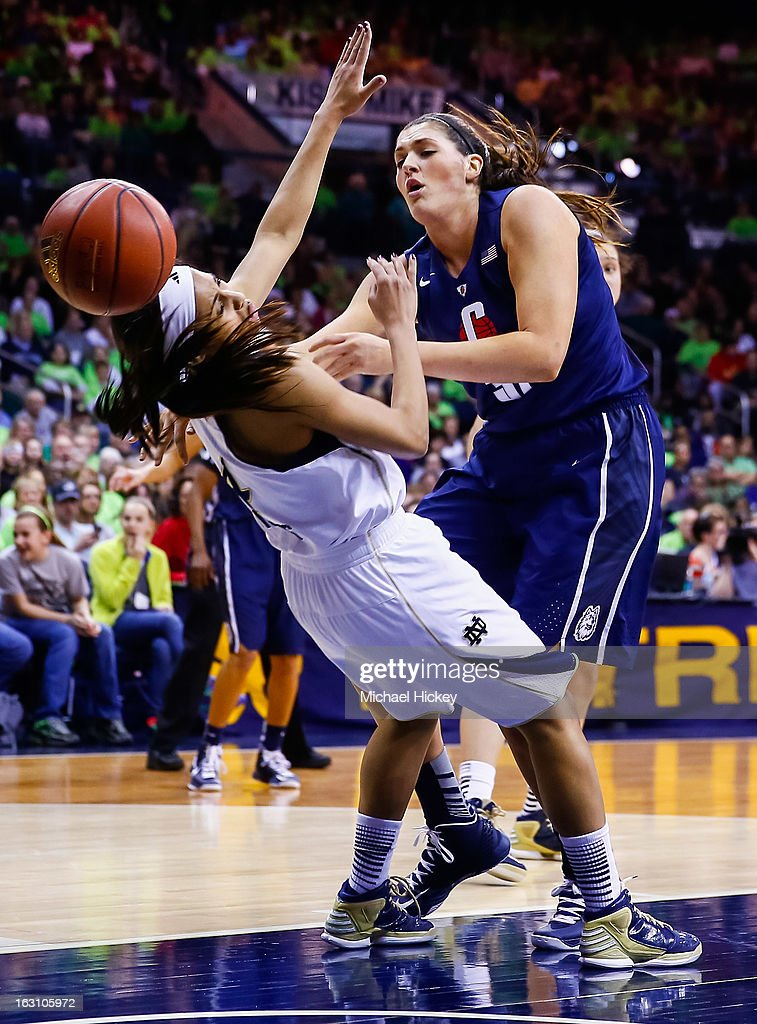 Skylar Diggins #4 of the Notre Dame Fighting Irish takes a charge from Stefanie Dolson #31 of the Connecticut Huskies at Purcel Pavilion on March 4, 2013 in South Bend, Indiana.