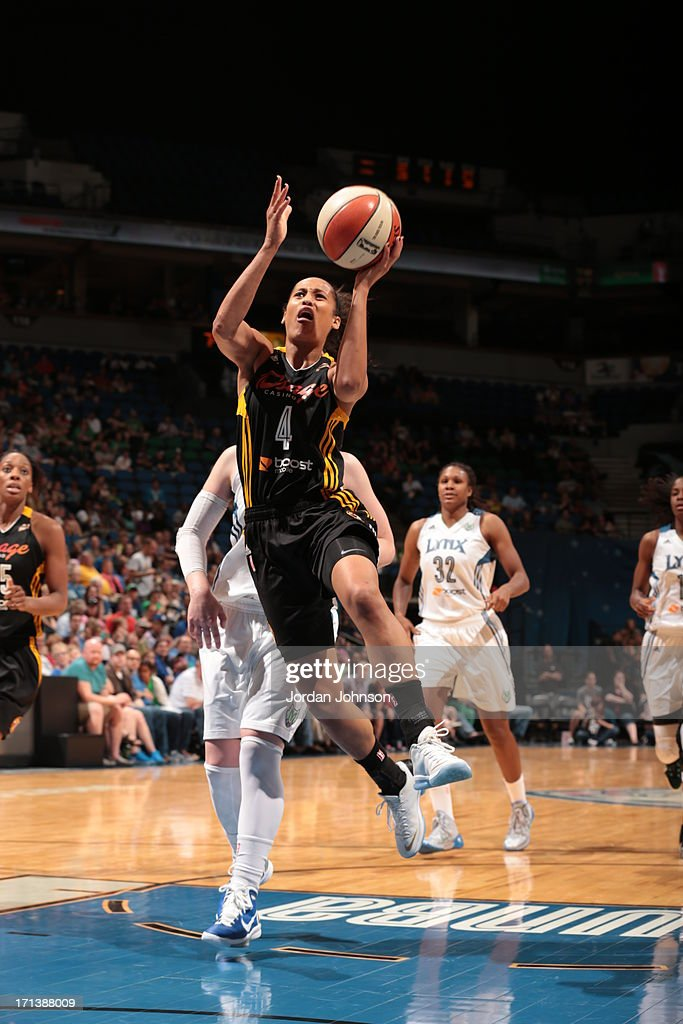 <a gi-track='captionPersonalityLinkClicked' href=/galleries/search?phrase=Skylar+Diggins&family=editorial&specificpeople=5791961 ng-click='$event.stopPropagation()'>Skylar Diggins</a> #4 of the the Tulsa Shock shoots against the Minnesota Lynx during the WNBA game on June 23, 2013 at Target Center in Minneapolis, Minnesota.