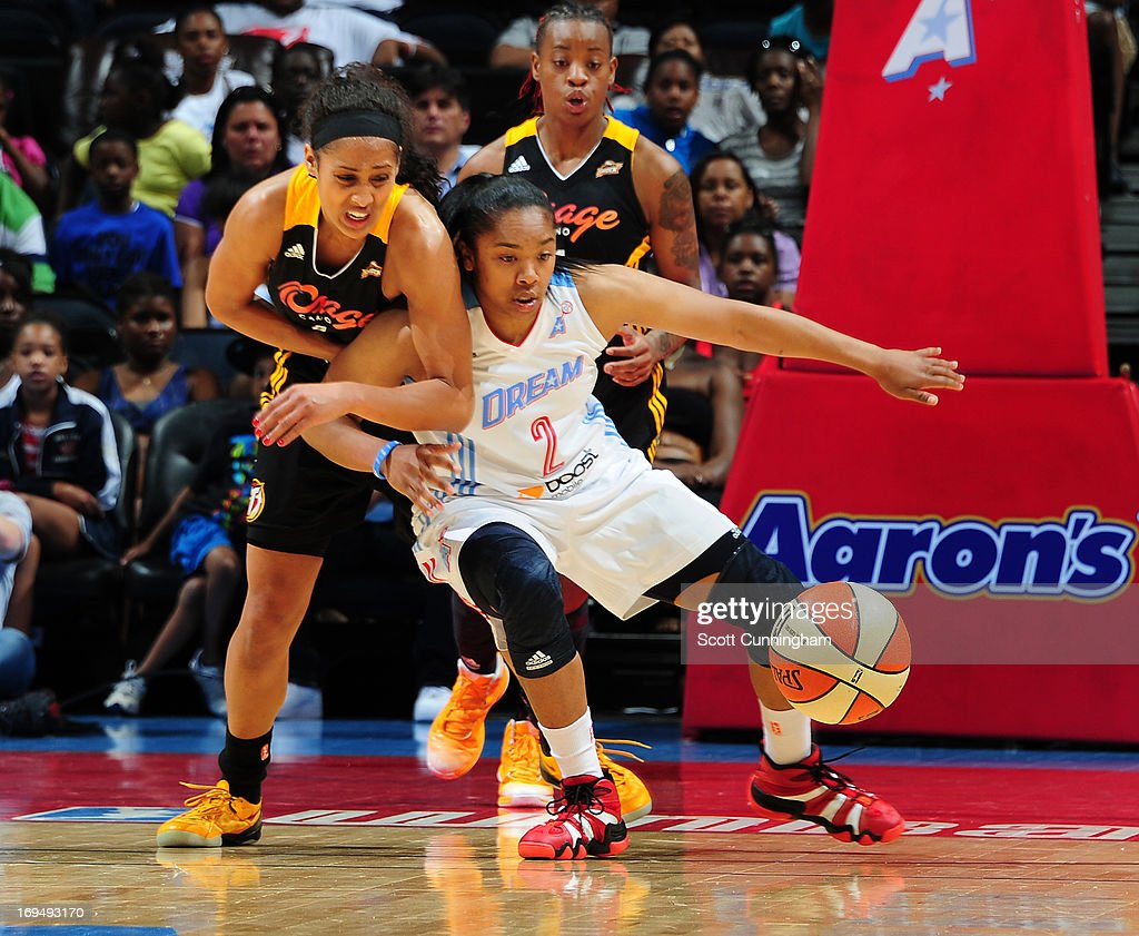 Skylar Diggins #4 of the Tulsa Shock battles for a loose ball against Alex Bentley #2 of the Atlanta Dream at Philips Arena on May 25, 2013 in Atlanta, Georgia.