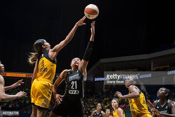 Skylar Diggins of the Tulsa Shock blocks a shot against Kayla McBride of the San Antonio Stars on July 17 2014 at the BOK Center in Tulsa Oklahoma...