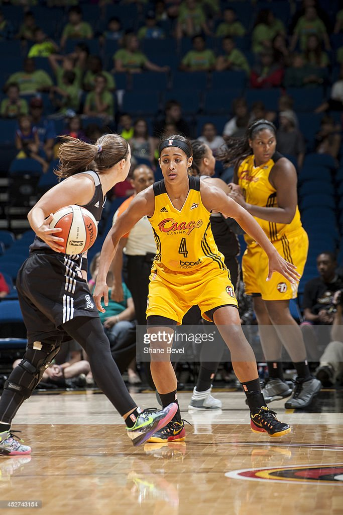 <a gi-track='captionPersonalityLinkClicked' href=/galleries/search?phrase=Skylar+Diggins&family=editorial&specificpeople=5791961 ng-click='$event.stopPropagation()'>Skylar Diggins</a> #4 of the Tulsa Shock defends against <a gi-track='captionPersonalityLinkClicked' href=/galleries/search?phrase=Becky+Hammon&family=editorial&specificpeople=203174 ng-click='$event.stopPropagation()'>Becky Hammon</a> #25 of the San Antonio Stars during the WNBA game on July 17, 2014 at the BOK Center in Tulsa, Oklahoma.