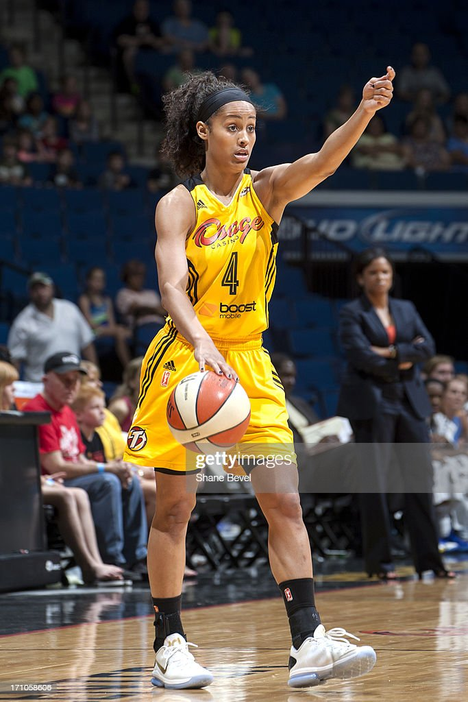 <a gi-track='captionPersonalityLinkClicked' href=/galleries/search?phrase=Skylar+Diggins&family=editorial&specificpeople=5791961 ng-click='$event.stopPropagation()'>Skylar Diggins</a> #4 of the Tulsa Shock dribbles the ball against the Chicago Sky during the WNBA game on June 20, 2013 at the BOK Center in Tulsa, Oklahoma.