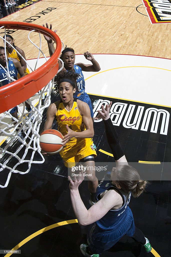 <a gi-track='captionPersonalityLinkClicked' href=/galleries/search?phrase=Skylar+Diggins&family=editorial&specificpeople=5791961 ng-click='$event.stopPropagation()'>Skylar Diggins</a> #4 of the Tulsa Shock drives to the basket against the Minnesota Lynx during the WNBA game on June 14, 2013 at the BOK Center in Tulsa, Oklahoma.