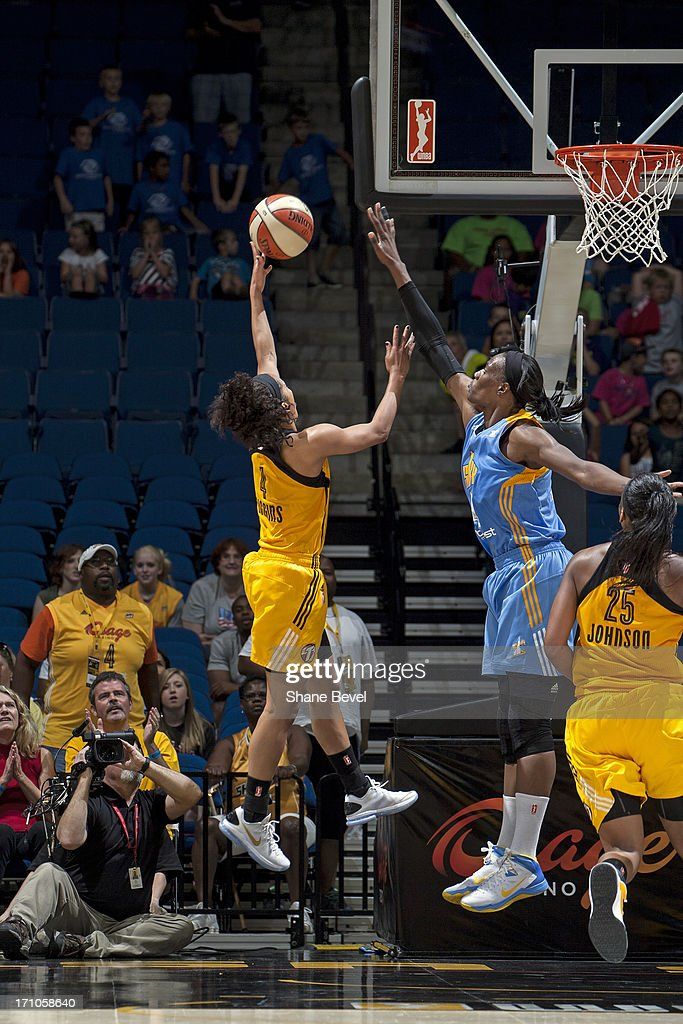 <a gi-track='captionPersonalityLinkClicked' href=/galleries/search?phrase=Skylar+Diggins&family=editorial&specificpeople=5791961 ng-click='$event.stopPropagation()'>Skylar Diggins</a> #4 of the Tulsa Shock drives to the basket against the Chicago Sky during the WNBA game on June 20, 2013 at the BOK Center in Tulsa, Oklahoma.