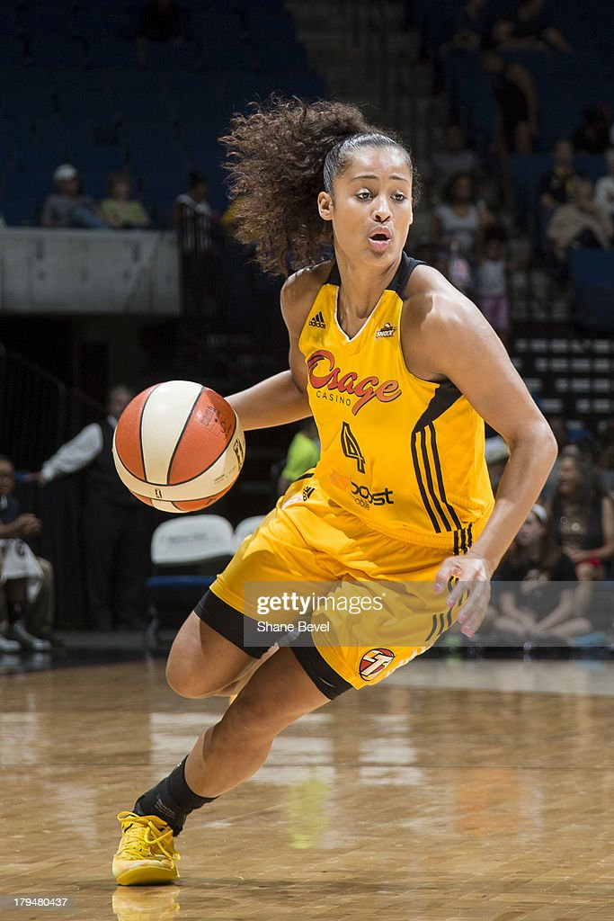 <a gi-track='captionPersonalityLinkClicked' href=/galleries/search?phrase=Skylar+Diggins&family=editorial&specificpeople=5791961 ng-click='$event.stopPropagation()'>Skylar Diggins</a> #4 of the Tulsa Shock drives to the basket during the WNBA game against the San Antonio Silver Stars on August 30, 2013 at the BOK Center in Tulsa, Oklahoma.