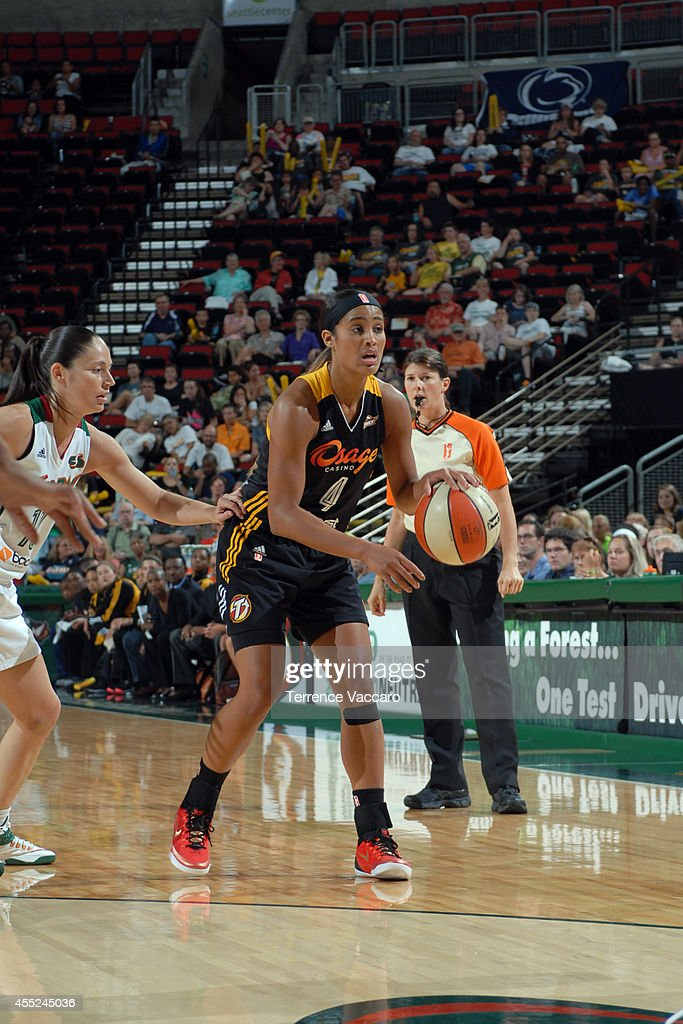 <a gi-track='captionPersonalityLinkClicked' href=/galleries/search?phrase=Skylar+Diggins&family=editorial&specificpeople=5791961 ng-click='$event.stopPropagation()'>Skylar Diggins</a> #4 of the Tulsa Shock handles the ball against the Seattle Storm during the game on August 10,2014 at Key Arena in Seattle, Washington.