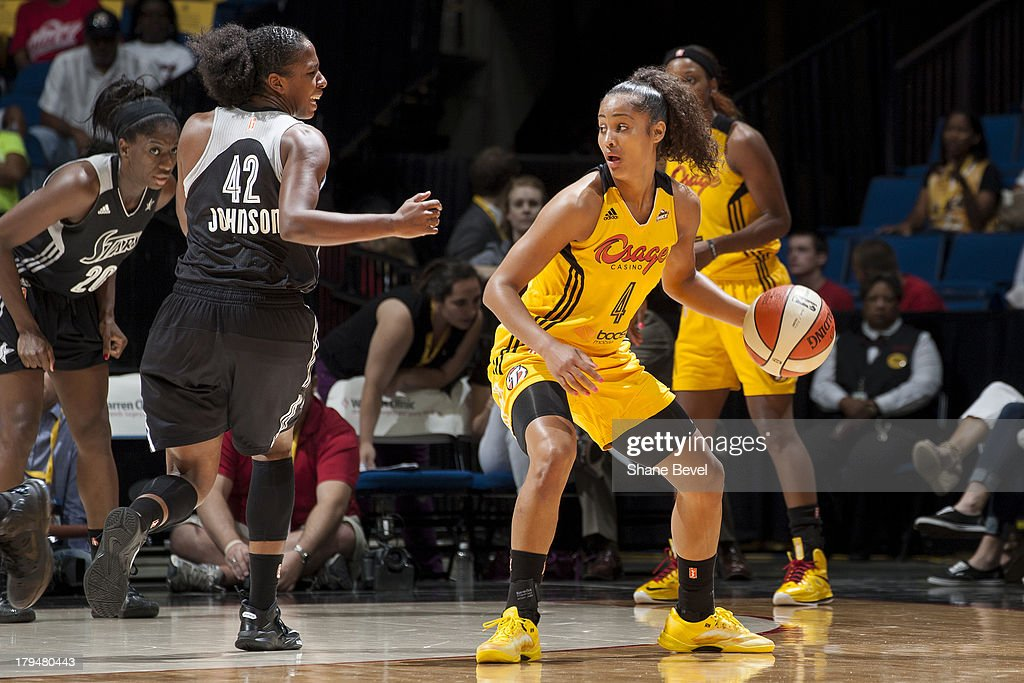 <a gi-track='captionPersonalityLinkClicked' href=/galleries/search?phrase=Skylar+Diggins&family=editorial&specificpeople=5791961 ng-click='$event.stopPropagation()'>Skylar Diggins</a> #4 of the Tulsa Shock looks to pass the ball during the WNBA game against the San Antonio Silver Stars on August 30, 2013 at the BOK Center in Tulsa, Oklahoma.