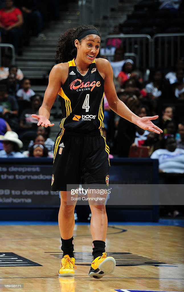 Skylar Diggins #4 of the Tulsa Shock reacts to a play against the Atlanta Dream at Philips Arena on May 25, 2013 in Atlanta, Georgia.