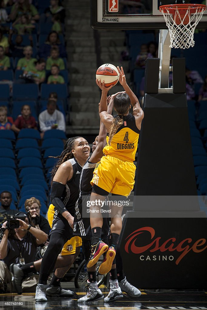 <a gi-track='captionPersonalityLinkClicked' href=/galleries/search?phrase=Skylar+Diggins&family=editorial&specificpeople=5791961 ng-click='$event.stopPropagation()'>Skylar Diggins</a> #4 of the Tulsa Shock shoots against the San Antonio Stars during the WNBA game on July 17, 2014 at the BOK Center in Tulsa, Oklahoma.