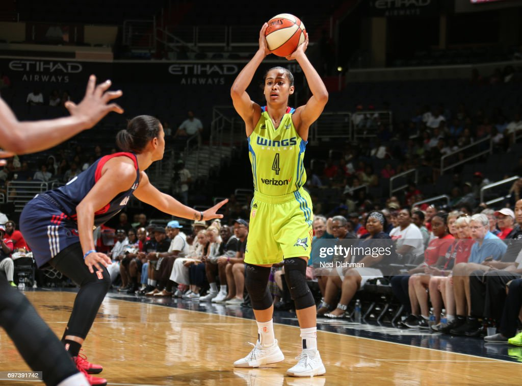 Skylar Diggins-Smith #4 of the Dallas Wings looks to pass the ball during a game against the Washington Mystics on June 18, 2017 at the Verizon Center in Washington, DC.