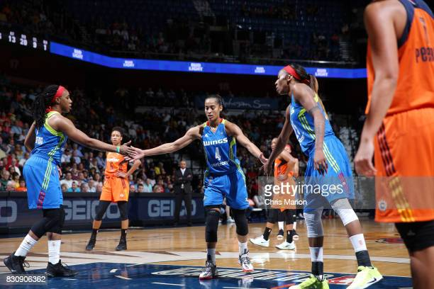 Skylar DigginsSmith of the Dallas Wings shakes hands with teammates during the game against the Connecticut Sun on August 12 2017 at Mohegan Sun...