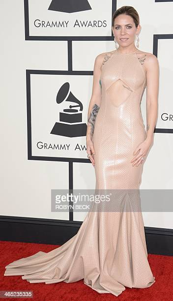 Skylar Grey arrives on the red carpet for the 56th Grammy Awards at the Staples Center in Los Angeles California January 26 2014 AFP PHOTO ROBYN BECK