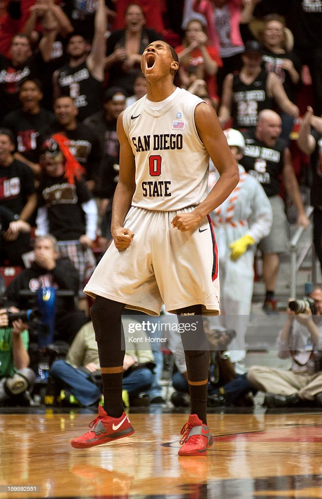 Skylar Spencer #0 of the San Diego State Aztecs yells in celebration after scoring and being fouled late in the second half of the game against the UNLV Runnin' Rebels at Viejas Arena on January 16, 2013 in San Diego, California.