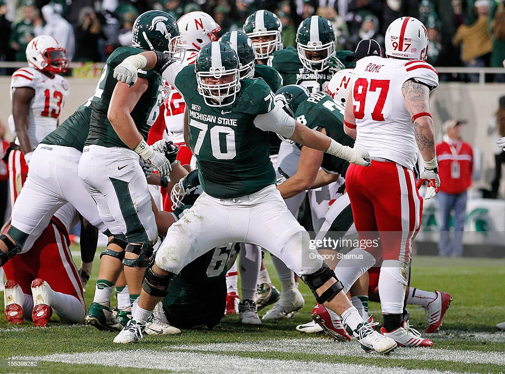 Skyler Burkland #70 of the Michigan State Spartans reacts after a fourth quarter Le'Veon Bell #24 touchdown while playing the Nebraska Cornhuskers at Spartan Stadium Stadium on November 3, 2012 in East Lansing, Michigan. Nebraska won the game 28-24.