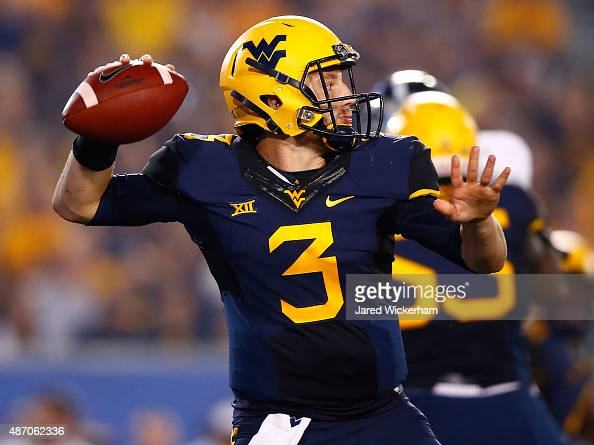 Skyler Howard of the West Virginia Mountaineers throws a pass in the second half against the Georgia Southern Eagles during the game at Mountaineer...